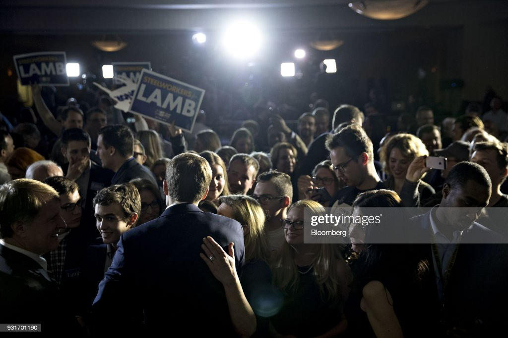 Conor Lamb, Democratic candidate for the U.S. House of Representatives, center left, greets attendees after speaking during an election night rally in Canonsburg, Pennsylvania, U.S., on Wednesday, March 14, 2018. Lamb and Republican Rick Saccone were locked in a tight contest for a House seat in Pennsylvania that may be a bellwether for the fall elections that will decide control of Congress. Photographer: Andrew Harrer/Bloomberg via Getty Images