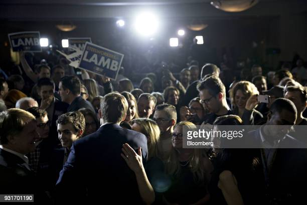 Conor Lamb Democratic candidate for the US House of Representatives center left greets attendees after speaking during an election night rally in...