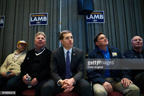 Conor Lamb Democratic Congressional candidate for Pennsylvania's 18th district sits with supporters as he waits to speak at a rally at the United...