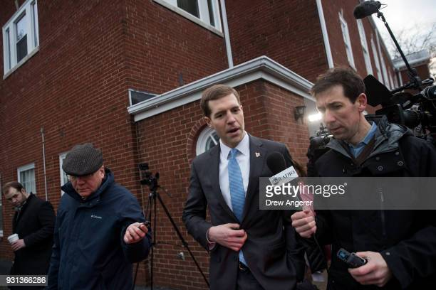Conor Lamb Democratic congressional candidate for Pennsylvania's 18th district speaks to reporters after voting at his polling station at First...