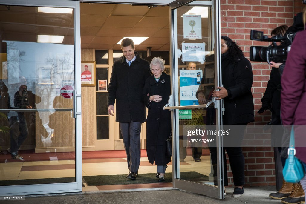 Conor Lamb, Democratic congressional candidate for Pennsylvania's 18th district, and his grandmother Barbara Lamb exit the polling station after she voted at Our Lady of Victory Church, March 13, 2018 in Carnegie, Pennsylvania. Voters head to the polls today as Lamb is running in a tight race for the vacated seat of Rep. Tim Murphy (R-PA) against Republican candidate Rick Saccone.