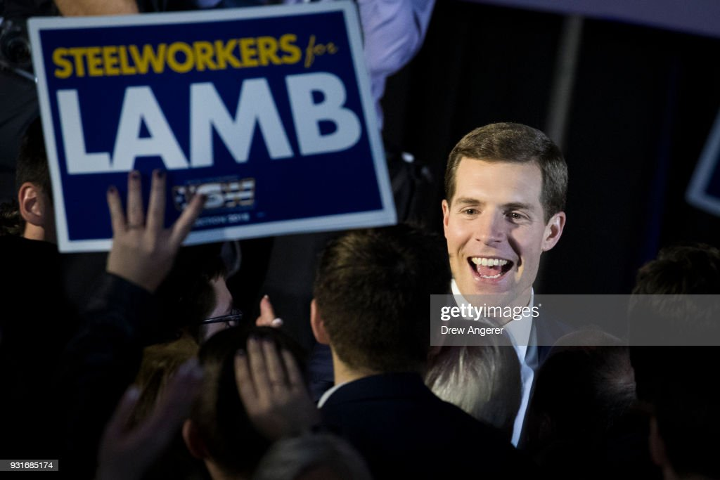 Conor Lamb, Democratic congressional candidate for Pennsylvania's 18th district, greets supporters at an election night rally March 14, 2018 in Canonsburg, Pennsylvania. Lamb claimed victory against Republican candidate Rick Saccone, but many news outlets report the race as too close to call.