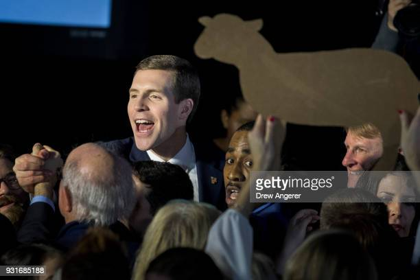 Conor Lamb Democratic congressional candidate for Pennsylvania's 18th district greets supporters at an election night rally March 14 2018 in...