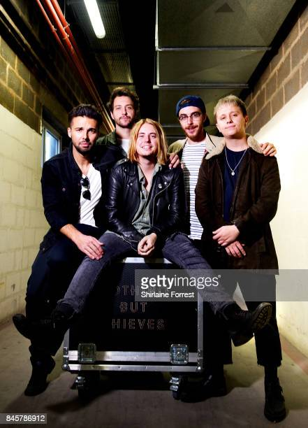 Conor Mason Joe LangridgeBrown Dominic Craik Philip Blake and James Price of Nothing But Thieves pose backstage after performing live and signing...