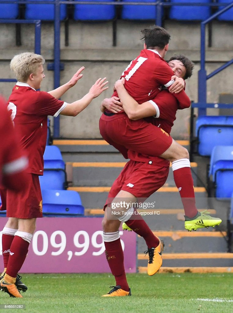 Conor Masterson (right) of Liverpool celebrates after scoring the fourth goal for Liverpool with team mate Liam Millar during the UEFA Champions League group E match between Liverpool FC and Sevilla FC at Prenton Park on September 13, 2017 in Birkenhead, United Kingdom.