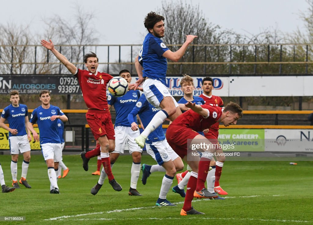 Conor Masterson (right) of Liverpool is fouled by Fraser Hornby of Everton inside the penalty area during the Everton v Liverpool PL2 game on April 16, 2018 in Southport, England.