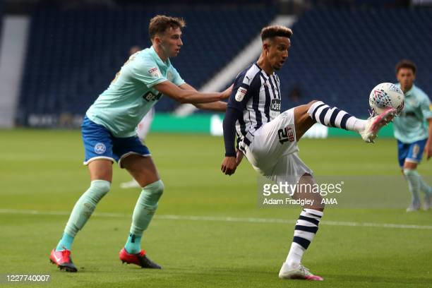 Conor Masterson of Queens Park Rangers and Callum Robinson of West Bromwich Albion during the Sky Bet Championship match between West Bromwich Albion...