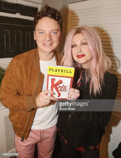Conor Maynard and Composer of 'Kinky Boots' Cyndi Lauper pose backstage at the hit musical 'Kinky Boots' on Broadway at The Hirshfeld Theater on...
