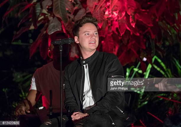 Conor Maynard performs during a Barry's Bootcamp workout session in the sky to support Stand Up To Cancer at The Sky Garden on October 3 2016 in...