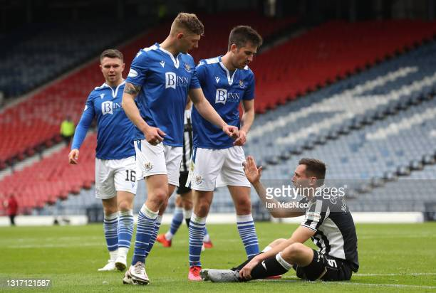 Conor McCarthy of St Mirren looks dejected is helped up by Liam Gordon and Callum Booth of St Johnstone after during the William Hill Scottish Cup...