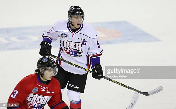 Conor McDavid of Team Orr and Graham Knott of Team Cherry watch for the puck during the 2015 BMO CHL/NHL Top Prospects Game at the Meridian Centre on...