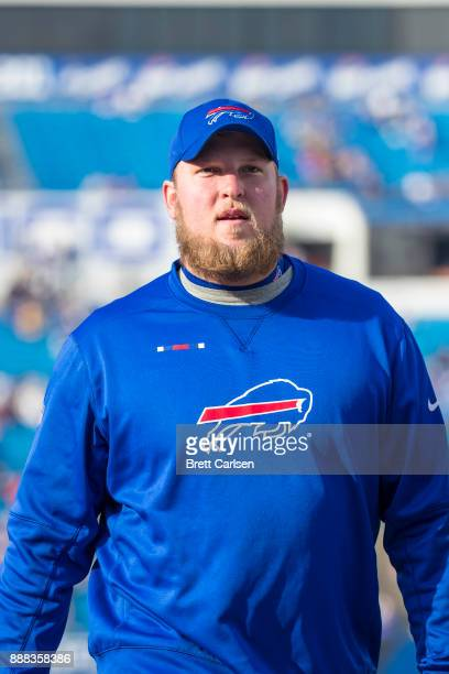 Conor McDermott of the Buffalo Bills leaves the field after warm ups for the game against the New England Patriots at New Era Field on December 3...