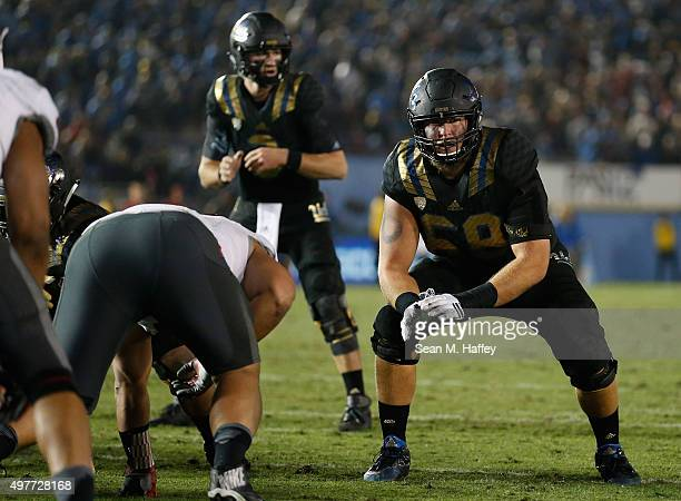 Conor McDermott of the UCLA Bruins prepares turnover block for Josh Rosen of the UCLA Bruins during a game against the Washington State Cougars at...