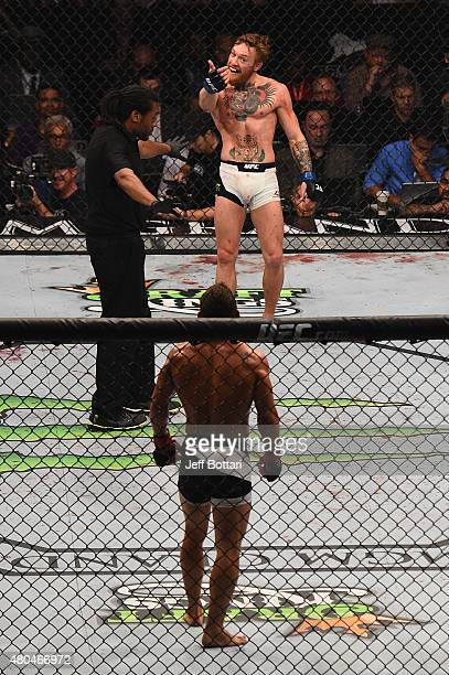 Conor McGregor and Chad Mendes face off during the UFC 189 event inside MGM Grand Garden Arena on July 11 2015 in Las Vegas Nevada