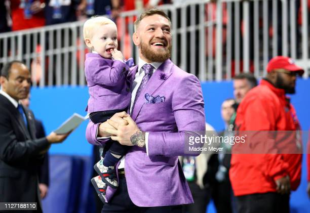 Conor McGregor and Conor McGregor Jr attend Super Bowl LIII between the New England Patriots and the Los Angeles Rams at MercedesBenz Stadium on...