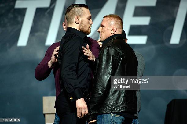 Conor McGregor and Dennis Siver face off during the UFC Time Is Now press conference at The Smith Center for the Performing Arts on November 17 2014...