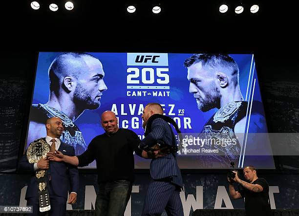 Conor McGregor and Eddie Alvarez faceoff as UFC president Dana White breaks them up at the UFC 205 press conference at The Theater at Madison Square...