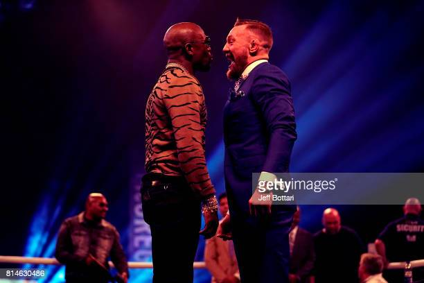 Conor McGregor and Floyd Mayweather Jr face off during the Floyd Mayweather Jr v Conor McGregor World Press Tour event at SSE Arena on July 14 2017...
