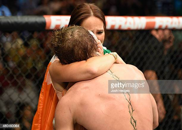 Conor McGregor and his girlfriend embraec after his UFC interim featherweight title fight during the UFC 189 event inside MGM Grand Garden Arena on...