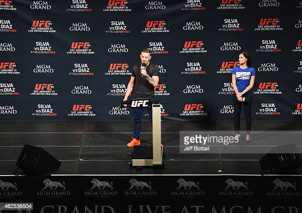 Conor McGregor and UFC host Megan Olivi and interact with fans during the QA before the UFC 183 weighin at the MGM Grand Garden Arena on January 30...
