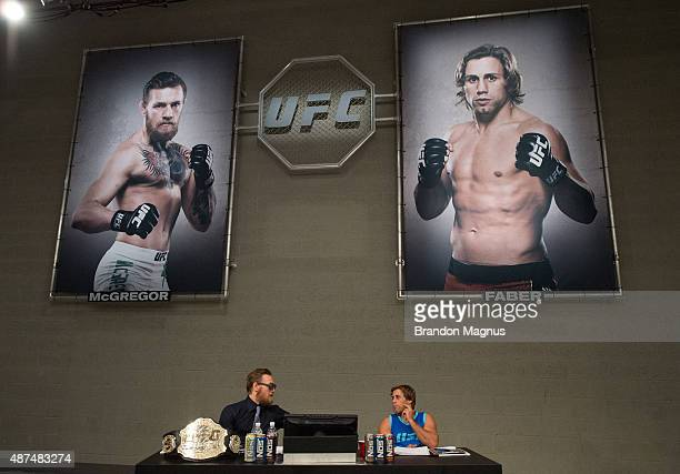 Conor McGregor and Urijah Faber discuss the elimination fights at the UFC TUF Gym on July 17 2015 in Las Vegas Nevada