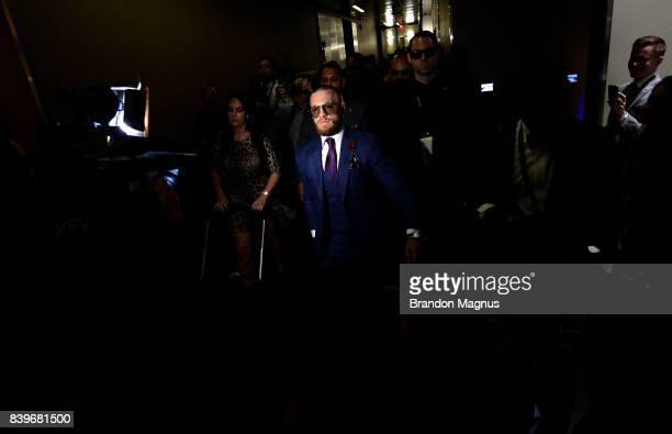 Conor McGregor arrives for his super welterweight boxing match against Floyd Mayweather Jr on August 26 2017 at TMobile Arena in Las Vegas Nevada