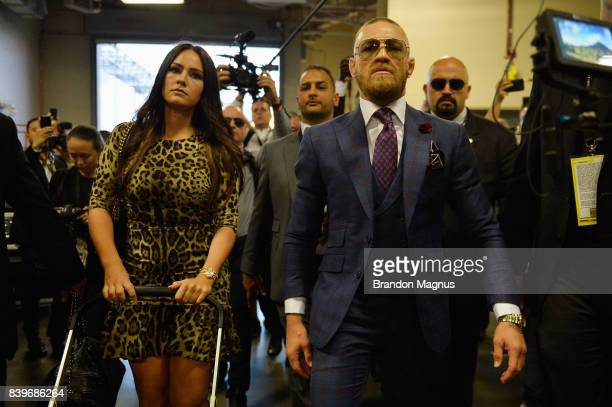 Conor McGregor arrives with Dee Devlin for his super welterweight boxing match against Floyd Mayweather Jr on August 26 2017 at TMobile Arena in Las...