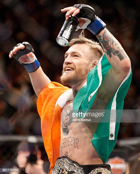 Conor McGregor celebrates after a firstround knockout victory over Jose Aldo in their featherweight title fight during UFC 194 on December 12 2015 in...