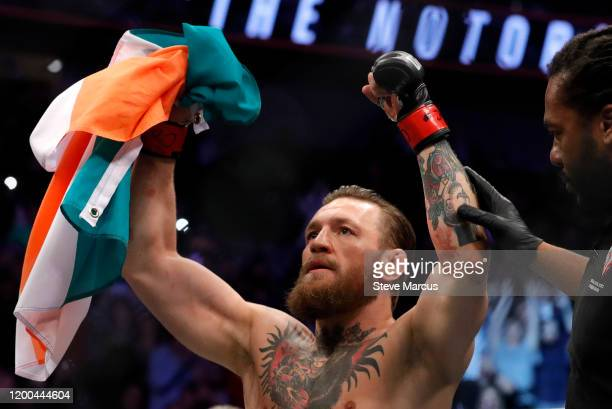 Conor McGregor celebrates after defeating Donald Cerrone in a welterweight bout during UFC246 at TMobile Arena on January 18 2020 in Las Vegas Nevada...