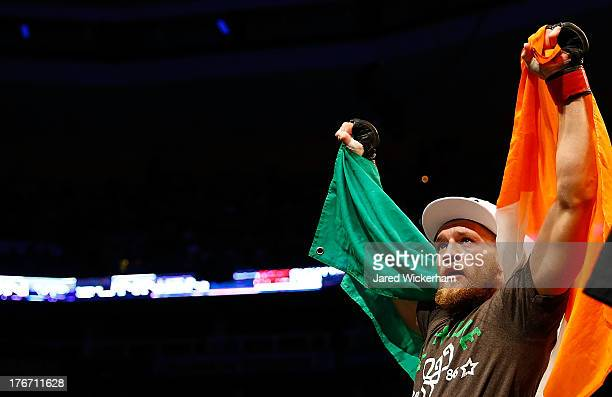Conor McGregor celebrates following his win against Max Holloway in their featherweight bout at TD Garden on August 17 2013 in Boston Massachusetts