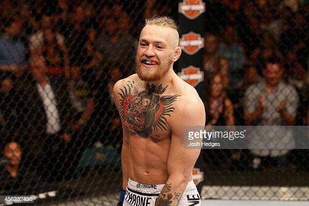 Conor McGregor celebrates his win over Dustin Poirier after their featherweight fight during the UFC 178 event inside the MGM Grand Garden Arena on...