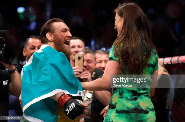 Conor McGregor celebrates with girlfriend Dee Devlin after defeating Donald Cerrone in a welterweight bout during UFC246 at TMobile Arena on January...