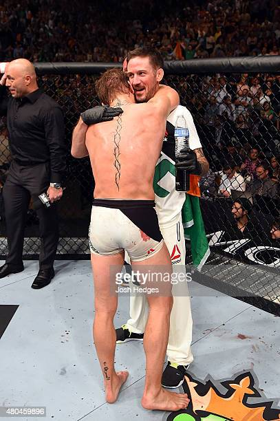Conor McGregor embraces a temmate after his UFC interim featherweight title fight during the UFC 189 event inside MGM Grand Garden Arena on July 11...