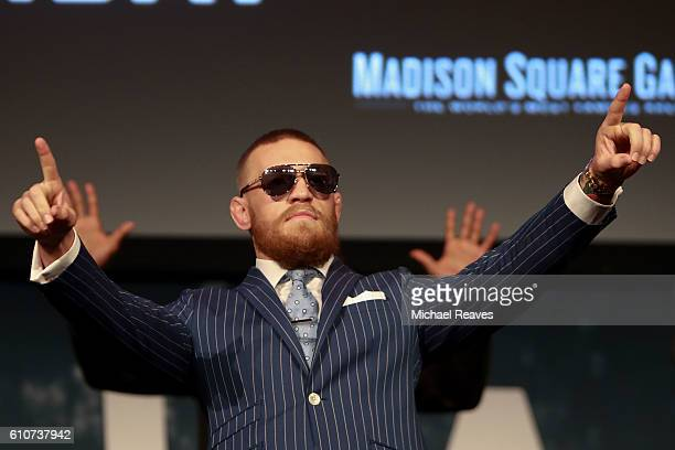Conor McGregor gestures to the crowd during the UFC 205 press conference at The Theater at Madison Square Garden on September 27 2016 in New York City