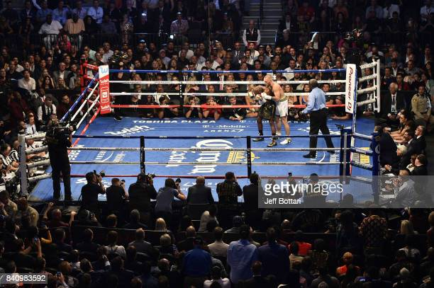 Conor McGregor holds Floyd Mayweather Jr in their super welterweight boxing match at TMobile Arena on August 26 2017 in Las Vegas Nevada Mayweather...