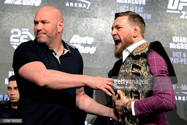 Conor McGregor is held back by UFC President Dana White during the UFC 229 Press Conference at Radio City Music Hall on September 20, 2018 in New...