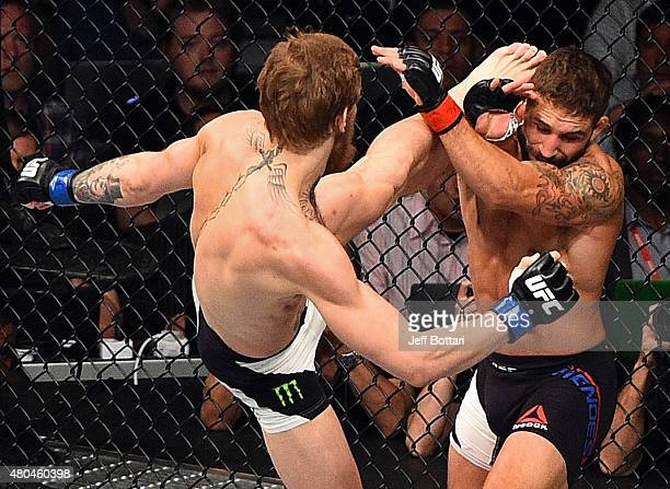 Conor McGregor kicks Chad Mendes during the UFC 189 event inside MGM Grand Garden Arena on July 11 2015 in Las Vegas Nevada