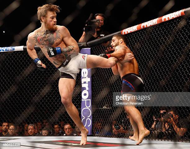 Conor McGregor kicks Chad Mendes in their UFC interim featherweight title fight during the UFC 189 event inside MGM Grand Garden Arena on July 11...