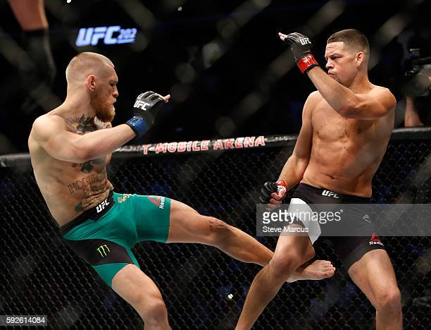 Conor McGregor kicks Nate Diaz during their welterweight rematch at the UFC 202 event at TMobile Arena on August 20 2016 in Las Vegas Nevada