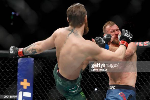 Conor McGregor lands a kick to the face of Donald Cerrone in the first round in a welterweight bout during UFC246 at TMobile Arena on January 18 2020...