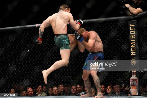 Conor McGregor lands a knee to the face of Donald Cerrone in the first round in a welterweight bout during UFC246 at TMobile Arena on January 18 2020...