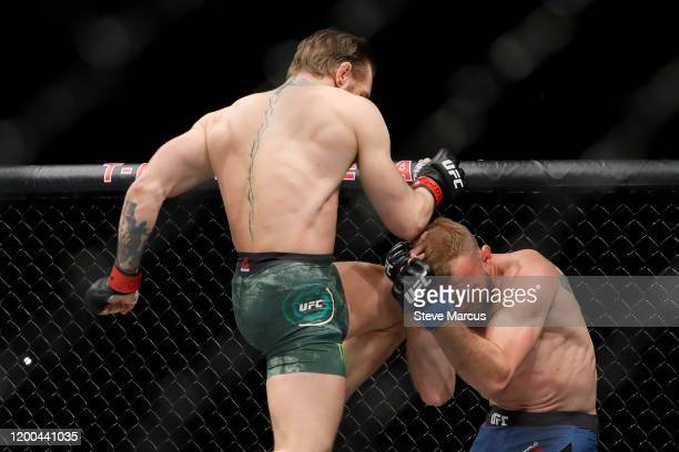 Conor McGregor lands a knee to the face of Donald Cerrone in the first round in a welterweight bout during UFC246 at T-Mobile Arena on January 18,...