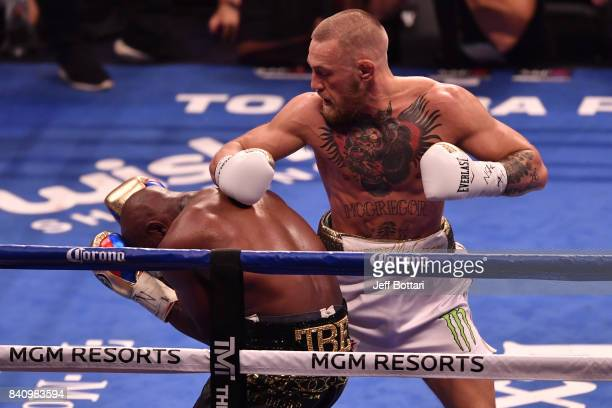 Conor McGregor looks to punch Floyd Mayweather Jr as he turns his back to Conor in their super welterweight boxing match at TMobile Arena on August...