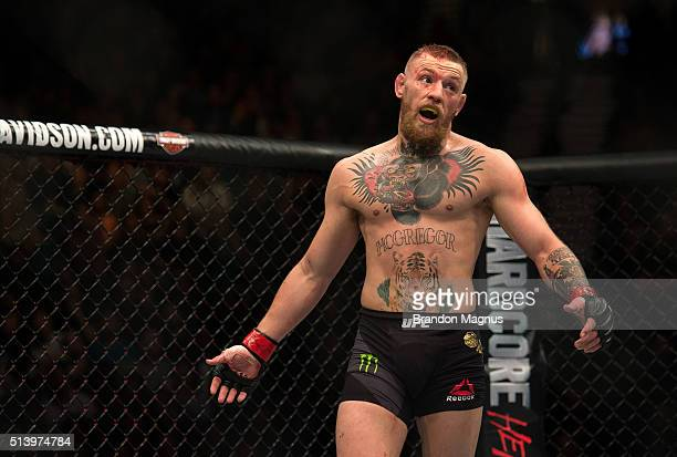 Conor McGregor mocks Nate Diaz in their welterweight bout during the UFC 196 in the MGM Grand Garden Arena on March 5 2016 in Las Vegas Nevada