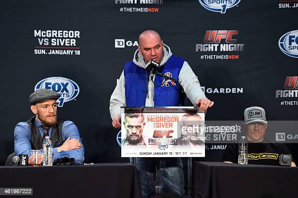 Conor McGregor of Ireland addresses the media with UFC President Dana White and Dennis Siver of Germany at the post fight press conference during the...