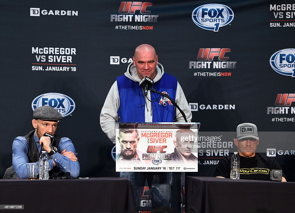 Conor McGregor of Ireland addresses the media with UFC President Dana White and Dennis Siver of Germany at the post fight press conference during the UFC Fight Night event at the TD Garden on January 18, 2015 in Boston, Massachusetts.