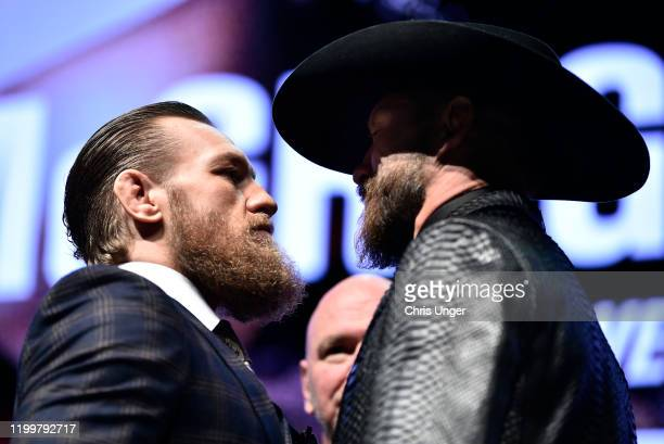 Conor McGregor of Ireland and Donald Cerrone face off during the UFC 246 press conference at Pearl Theater at the Palms Casino Resort on January 15...