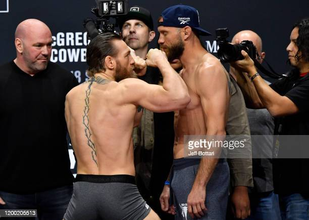 Conor McGregor of Ireland and Donald Cerrone face off during the UFC 246 weigh-in at Park Theater at Park MGM on January 17, 2020 in Las Vegas,...