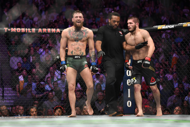 Conor McGregor of Ireland and Khabib Nurmagomedov of Russia exchange words after the second round in their UFC lightweight championship bout during...