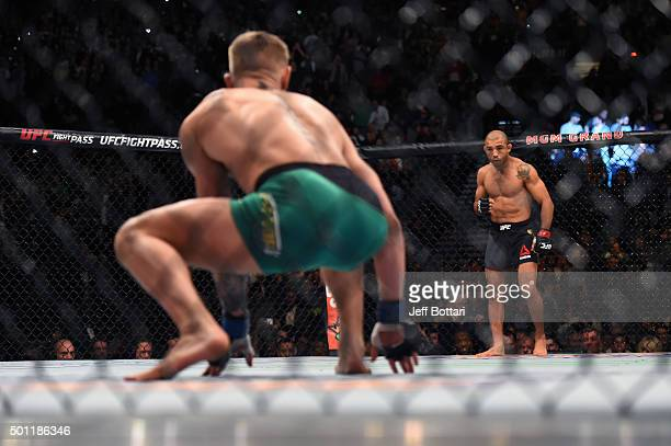 Conor McGregor of Ireland crouches in his corner while staring down Jose Aldo of Brazil before their featherweight championship bout during the UFC...